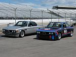 Coupes side by side at the track.